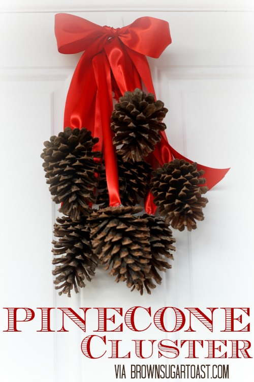 Knock-off Pottery Barn Pinecone Cluster - so festive! Plus, all it takes is ribbon, glue, and pinecones!