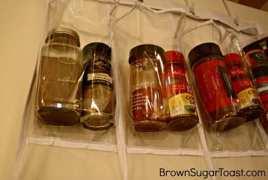 LOVE this idea! Organizing your spices using an over the door shoe holder! Perfect for different bottle/jar sizes!